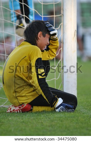 KAPOSVAR, HUNGARY - JULY 24: A sad ukrainian soccer player at the V. Youth Football Festival Under 12 Final - FK Klub 7 Tuzla (BIH) vs FC Munkachevo (UKR) - July 24, 2009 in Kaposvar, Hungary.