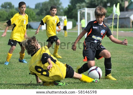 KAPOSVAR, HUNGARY - JULY 19: Unidentified players in action at a VI. Youth Football Festival match Efthymiades FA (CYP) vs. Academia Venezolana de Futból (VEN)- July 19, 2010 in Kaposvar, Hungary