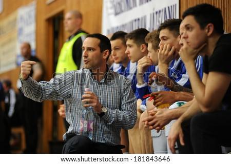 KAPOSVAR, HUNGARY - MARCH 8: Adam Fekete (Kaposvar trainer) in action at a Hungarian Championship basketball game with Kaposvar (white) vs. Paks (red) on March 8, 2014 in Kaposvar, Hungary. - stock photo