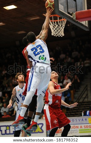 KAPOSVAR, HUNGARY - MARCH 8: Bennet Davis (white 23) in action at a Hungarian Championship basketball game with Kaposvar (white) vs. Paks (red) on March 8, 2014 in Kaposvar, Hungary.