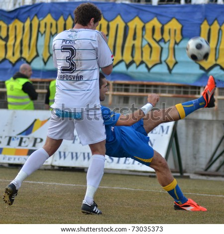 KAPOSVAR, HUNGARY - MARCH 12: Milan Peric (3) in action at a Hungarian National Championship soccer game Kaposvar vs Siofok March 12, 2011 in Kaposvar, Hungary.