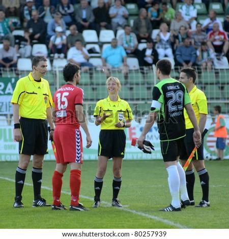 KAPOSVAR, HUNGARY - MAY 14: Gyongyi Gaal (FIFA referee) (C) in action before a Hungarian National Championship soccer game - Kaposvar vs Szolnok on May 14, 2011 in Kaposvar, Hungary. - stock photo