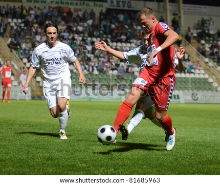 KAPOSVAR, HUNGARY - MAY 14: Lorant Olah (L) in action at a Hungarian National Championship soccer game - Kaposvar vs Szolnok on May 14, 2011 in Kaposvar, Hungary. - stock photo