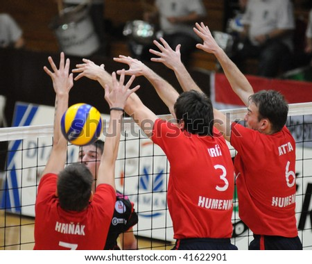 KAPOSVAR, HUNGARY - NOVEMBER 20: Hrinak (L), Kriz (C), and Matta (R) blocks the ball at a Middle European League volleyball game Kaposvar (HUN) vs Humenne (SVK), November 20, 2009 in Kaposvar, Hungary