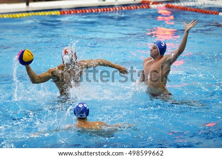 KAPOSVAR, HUNGARY - OCTOBER 5: Bence Hegedus (white 6) in action at a Hungarian national championship water-polo game between Kaposvar (white) and Honved (blue) on October 5, 2016 in Kaposvar, Hungary