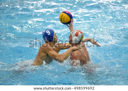 KAPOSVAR, HUNGARY - OCTOBER 5: David Dobos (in white) in action at a Hungarian national championship water-polo game between Kaposvari (white) and Honved (blue) on October 5, 2016 in Kaposvar, Hungary