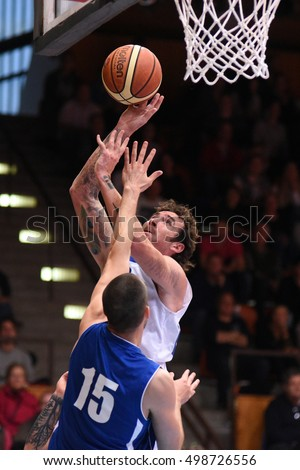 KAPOSVAR, HUNGARY - OCTOBER 6: Roland Hendlein (in white) in action at Hungarian Championship basketball game with Kaposvar (white) vs. Sopron (blue) on October 6, 2016 in Kaposvar, Hungary.