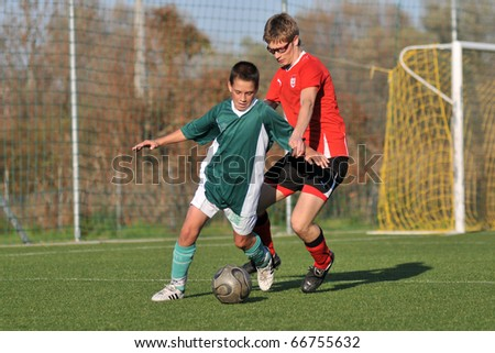 KAPOSVAR, HUNGARY - OCTOBER 30: Unidentified players in action at the Hungarian National Championship under 17 game between Kaposvar and Holler FC October 30, 2010 in Kaposvar, Hungary.