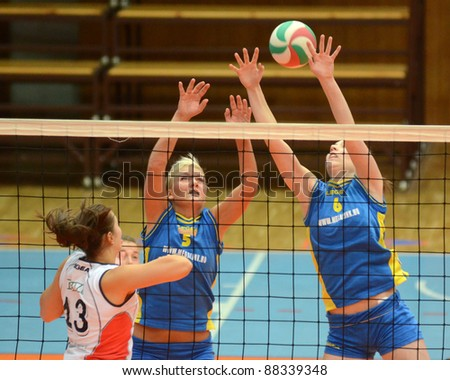 KAPOSVAR, HUNGARY - OCTOBER 21: Zsofia Horvath (R) in action at a Hungarian NB I. League volleyball game Kaposvar (blue) vs Godollo (white), October 21, 2011 in Kaposvar, Hungary.