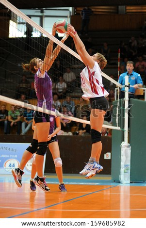 KAPOSVAR, HUNGARY - SEPTEMBER 20: Eszter Tobak (white 8) in action at the Hungarian I. League volleyball game Kaposvar (white) vs Ujpest (purple), September 20, 2013 in Kaposvar, Hungary. - stock photo