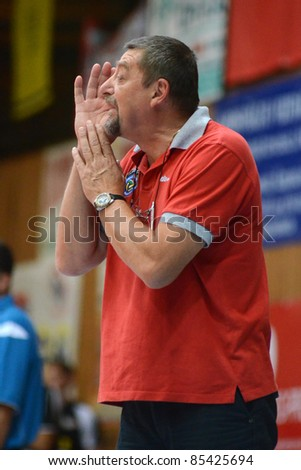 KAPOSVAR, HUNGARY - SEPTEMBER 21: Gyorgy Demeter (Kaposvar trainer) in action at a Hungarian Championship volleyball game Kaposvar (w) vs. Kecskemet (b), September 21, 2011 in Kaposvar, Hungary.