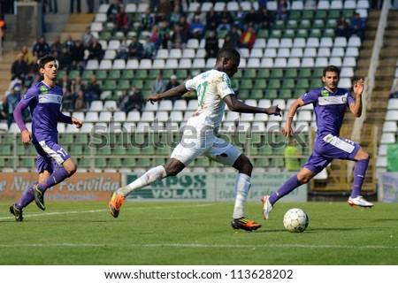 KAPOSVAR, HUNGARY - SEPTEMBER 14: Jammeh Haruna (in white) in action at a Hungarian National Championship soccer game - Kaposvar (white) vs Ujpest (purple) on September 14, 2012 in Kaposvar, Hungary. - stock photo