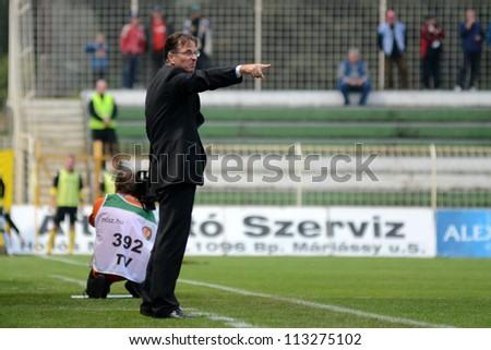 KAPOSVAR, HUNGARY - SEPTEMBER 14: Laszlo Prukner (Kaposvar trainer) in action at a Hungarian Championship soccer game - Kaposvar (white) vs Ujpest (purple) on September 14, 2012 in Kaposvar, Hungary. - stock photo