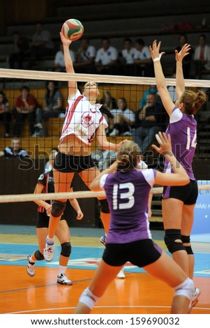 KAPOSVAR, HUNGARY - SEPTEMBER 20: Zs�³fia Harmath (white 3) in action at the Hungarian I. League volleyball game Kaposvar (white) vs Ujpest (purple), September 20, 2013 in Kaposvar, Hungary.