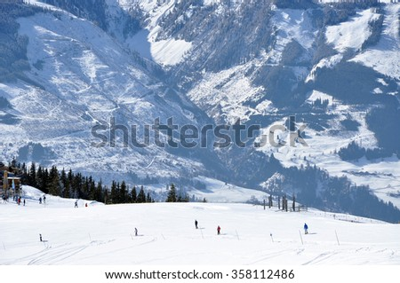 KAPRUN, AUSTRIA - MARCH 3, 2012: Skiers enjoying one of the last ski days of the season, skiing in the Austrian Alps