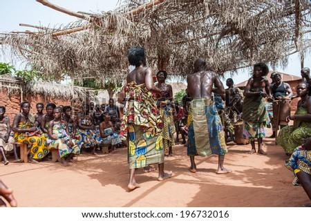 KARA, TOGO - MAR 11, 2012:  Unidentified Togolese people in a traditional clothes dance the religious voodoo dance. Voodoo is the West African religion