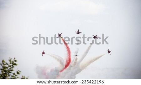 Karaaslan Hadimi Park, Konya, Turkey - August 14, 2014 : Turkish Air Force aerobatic demonstration team which called Turkish Stars are flying on the sky for 14 August - Karaaslan Hadimi Park in Konya - stock photo