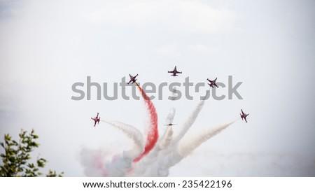 Karaaslan Hadimi Park, Konya, Turkey - August 14, 2014 : Turkish Air Force aerobatic demonstration team which called Turkish Stars are flying on the sky for 14 August - Karaaslan Hadimi Park in Konya - stock photo