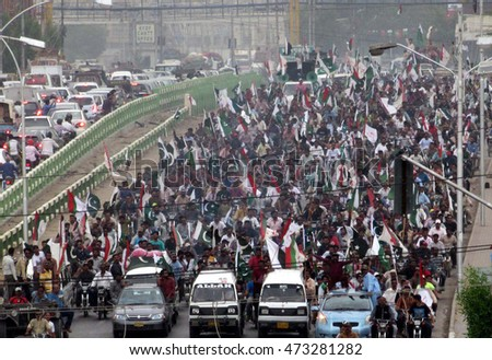 KARACHI, PAKISTAN - AUG 24: Activists of Mohajir Qaumi Movement are holding Pakistan Long Live Rally passing through road in Clifton area of Karachi on August 24, 2016.