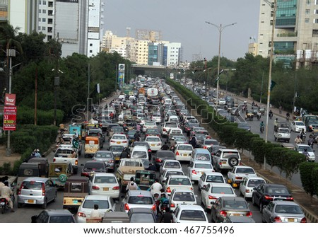 KARACHI, PAKISTAN - AUG 12: Huge numbers of motors are stuck in traffic jam due to the rally holding by Pak Sarzameen Party passing through Shahrah-e-Faisal on August 12, 2016 in Karachi.
