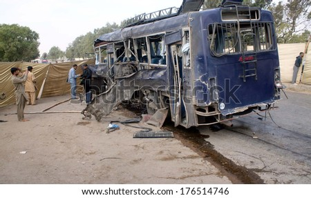 KARACHI, PAKISTAN - FEB 13: Views of venue after blast near a police bus which took place near the exit of the Razzaqabad Police Training Centre in Shah Latif Town on February 13, 2014 in Karachi.