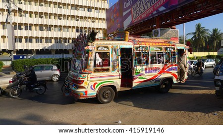 KARACHI, PAKISTAN - FEBRUARY 07: Bus art whereby the owners beautify the exterior and interior of the buses with glittering and colorful metallic and plastic sheets.  on February 07, 2016 in Karachi.  - stock photo