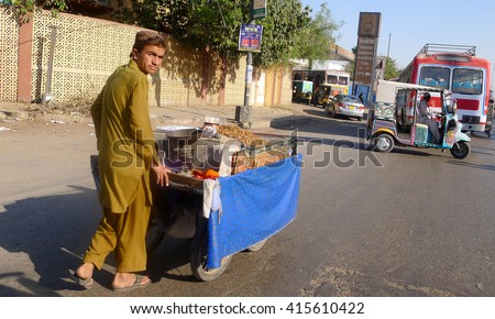 KARACHI, PAKISTAN - FEBRUARY 07: Poor Pakistani Trader at roadside on February 07, 2016 in Karachi.  - stock photo