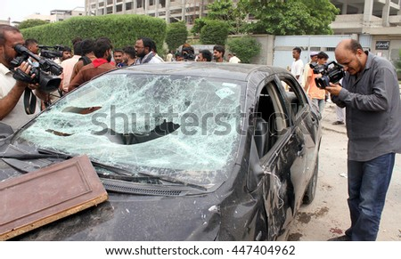 KARACHI, PAKISTAN - JUL 04: Laborers of denim mills smashed cars during demonstration against nonpayment of bonus and salaries on time before arrival of Eid-ul-Fitar in Karachi July 04, 2016.