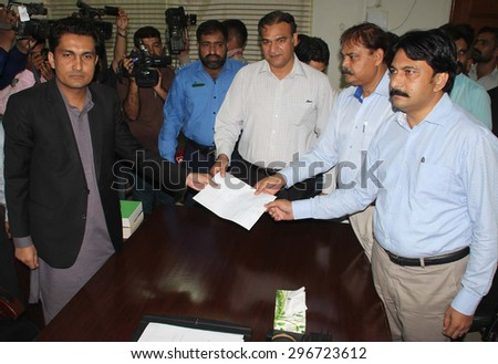 KARACHI, PAKISTAN - JUL 15: MQM??s Muhammad Hussain, Khalid Ahmed and Amir Moin Pirzada submitting a filed resolution condemning Imran Khan??s past statements against army on July 15, 2015 in Karachi.