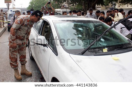 KARACHI, PAKISTAN - JUN 22: For forensic inspections security staffs cordon off venue just after the assassination of renowned Sufi singer Amjad Sabri Qawwal on June 22, 2016 in Karachi.