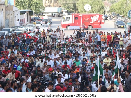 KARACHI, PAKISTAN - JUN 12: Journalists are protesting against license cancellation of  newly upcoming media group BOL Networks, during a demonstration on June 12, 2015 in Karachi.