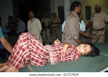 KARACHI, PAKISTAN - OCT 07: Injured child who was injured in bomb explosion being shifted at Jinnah hospital on October 07, 2010 in Karachi, Pakistan