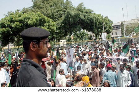KARACHI, PAKISTAN, SEPT 24: Flood affected people are protesting in favor of their demands during demonstration at Sindh assembly building in Karachi on Friday, September 24, 2010. - stock photo