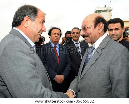 KARACHI, PAKISTAN - SEPT 29: Iran Interior Minister, Mostafa Mohammad Najjar being received by Sindh Chief Minister, Syed Qaim Ali Shah upon his arrival at Karachi airport on September 29, 2011.