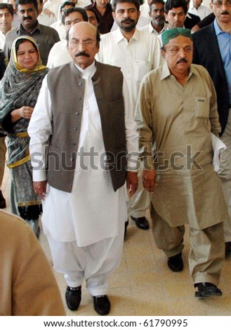 KARACHI, PAKISTAN, SEPT 24: Sindh Chief Minister Syed Qaim Ali Shah proceeds to assembly building hall to attend session in Karachi on Friday, September 24, 2010. (Rizwan Ali/PPI Images).