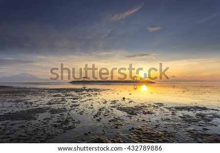 Karang beach, Sanur sunrise in Bali, Indonesia. View of two pagoda at the beach low tide. - stock photo
