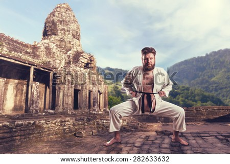 Karate fighter in karate stance - stock photo