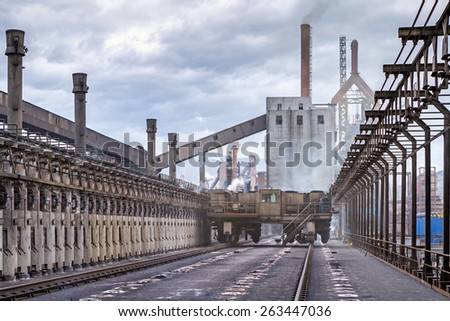 KARDEMIR, TURKEY - NOVEMBER 12, 2013: Normal operation of the coke battery with sprinkled operation, Turkey on November 2013. Coke battery in Kardemir Karabuk Iron and Steel Industry and Trade - stock photo