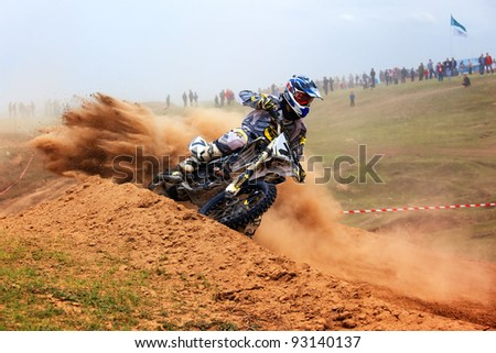 "KARGALY, KAZAKHSTAN - APRIL 10: A.Tindikov(7) in action at Motocross competition ""Fabrichny Cup""- Open Championship of Kazakhstan, on April 10, 2011 in Kargaly, Kazakhstan. - stock photo"