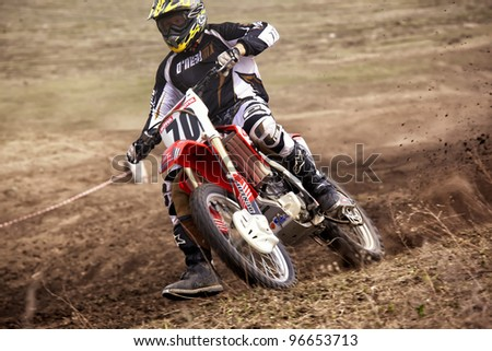 """KARGALY, KAZAKHSTAN - APRIL 10: V.Shevelev(70) in action at Motocross competition """"Fabrichny Cup""""- Open Championship of Kazakhstan, on April 10, 2011 in Kargaly, Kazakhstan. - stock photo"""