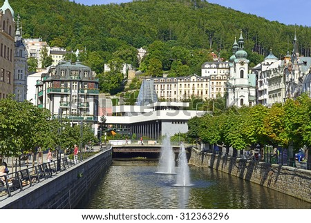 KARLOVY VARY, CZECH REPUBLIC - AUGUST 26, 2015: River Tepla (Warm) in the spa center. Karlovy Vary (Carlsbad) is world famous for its healing hot springs - stock photo