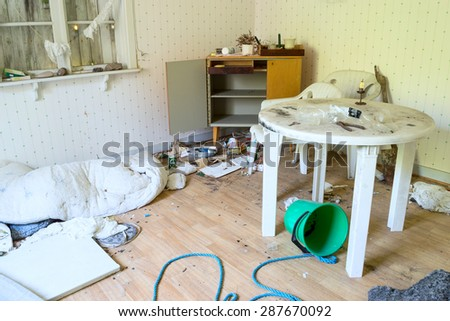 KARLSKRONA, SWEDEN - JUNE 15, 2015: The interior of an abandoned house with lots of debris. Places like this often become temporary homes for homeless people. - stock photo