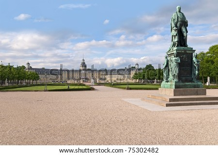 karlsruhe castle with statue park and fountain - stock photo