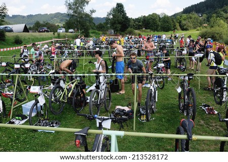 KAROLINKA, CZECH REPUBLIC - AUGUST 08, 2014: Racer prepare their bicycles in the depo at the Valachia Man triathlon - stock photo