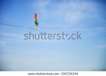 KAROLINO-BUGAZ, UKRAINE - AUGUST 22. Highline walker participating in competition at Z-Games extreme sports festival on August 22, 2015 in Karolino-Bugaz, Ukraine. - stock photo