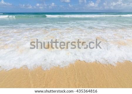 Karon beach at Phuket in the south of Thailand, beautiful sea, sun, sand, wave and foam.