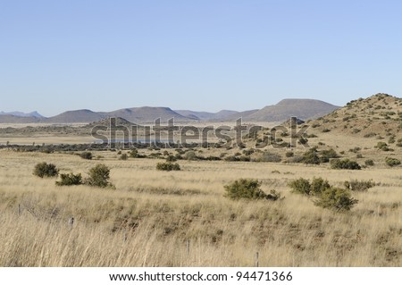 karoo scene, northern cape, south africa.  the karoo was once a vast paleolithic inland sea. the area has a unique geology and  is rich in fossils - stock photo