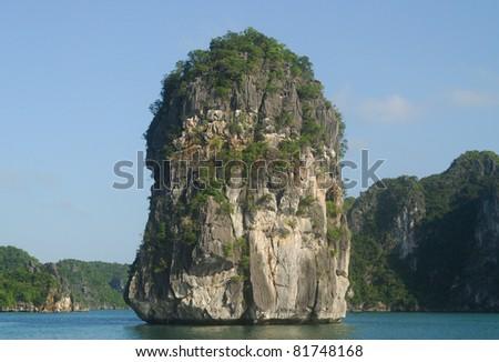 Karst island in Ha Long Bay, Vietnam - stock photo