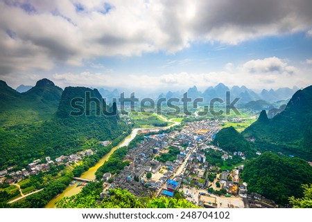 Karst Mountain landscape and village on the Li River in rural Guilin, Guangxi, China. - stock photo
