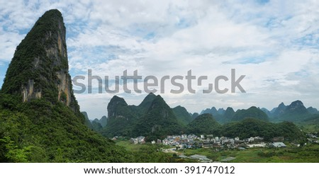 Karst mountains and fields from Moon hill near Yangshuo, Guangxi province, China - stock photo
